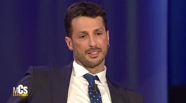 Fabrizio Corona dente rifatto