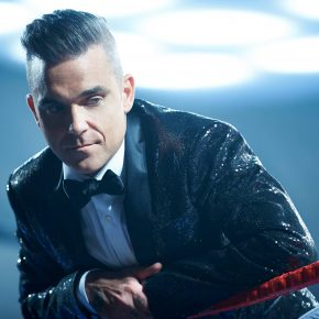 Robbie William malato: stop ai concerti per ernia al disco